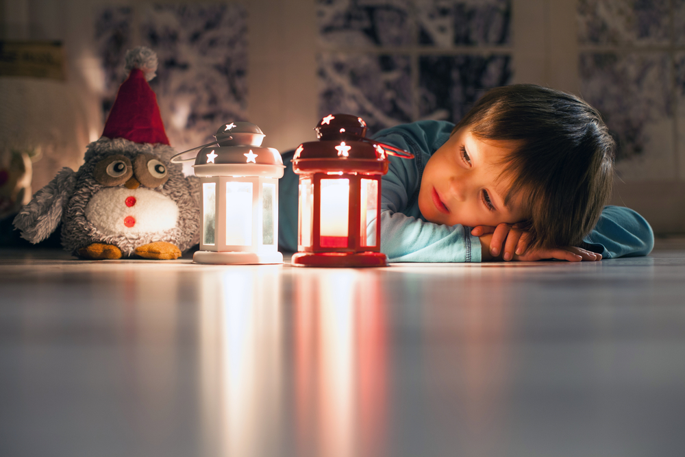 child in blackout, with battery powered night lights feeling safe